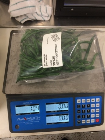 weighing green beans for packaging
